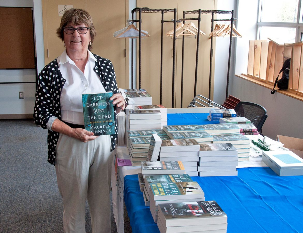 Maureen Jennings with her new book