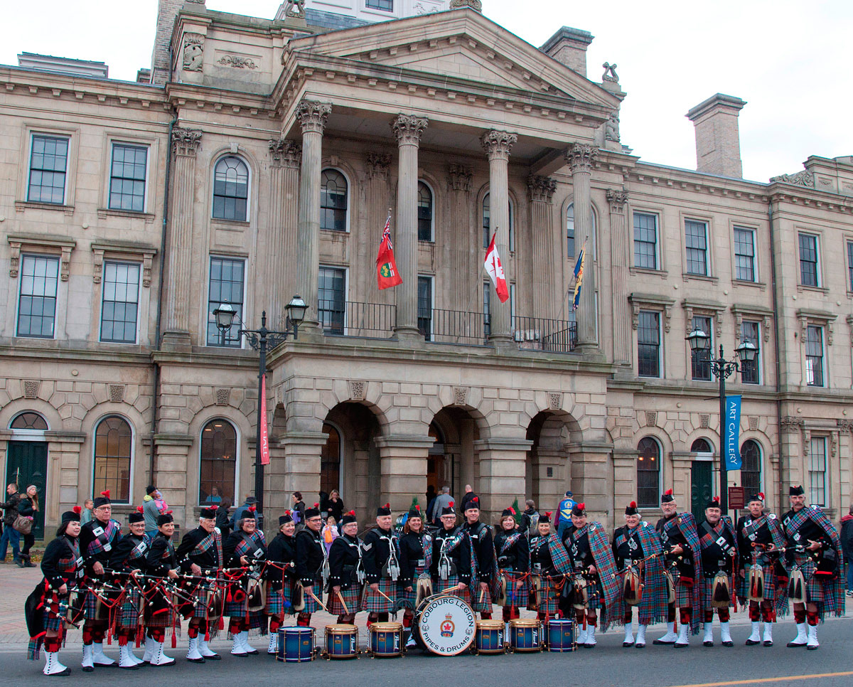 The Cobourg Legion Pipes and Drums assembled outside Victoria Hall