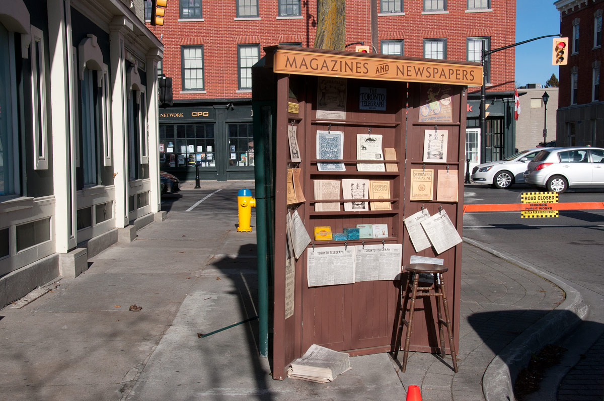 A prop on Third Street - newspaper stand covers Bell phone Booths