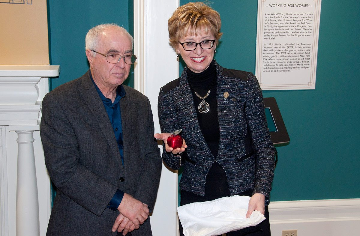MPP Lou Rinaldi and Minister.  She is showing Hoselton Apple presented to her by Eileen Lum from the County.