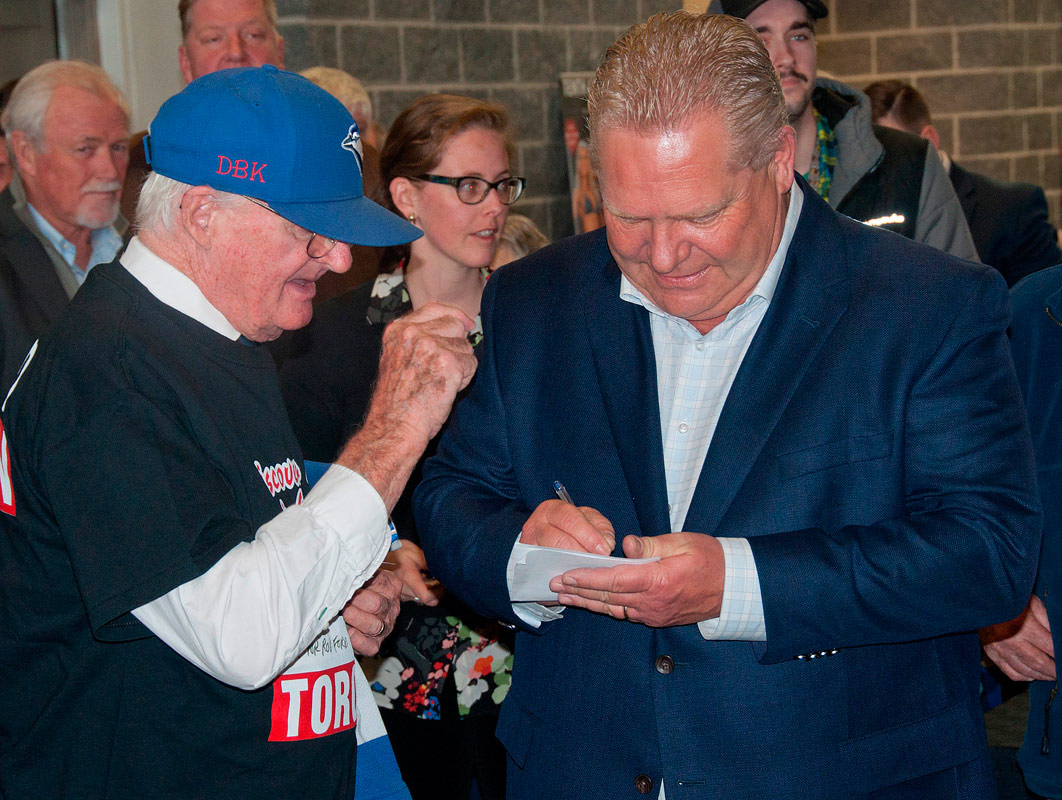 Doug Ford giving an autograph to a fan