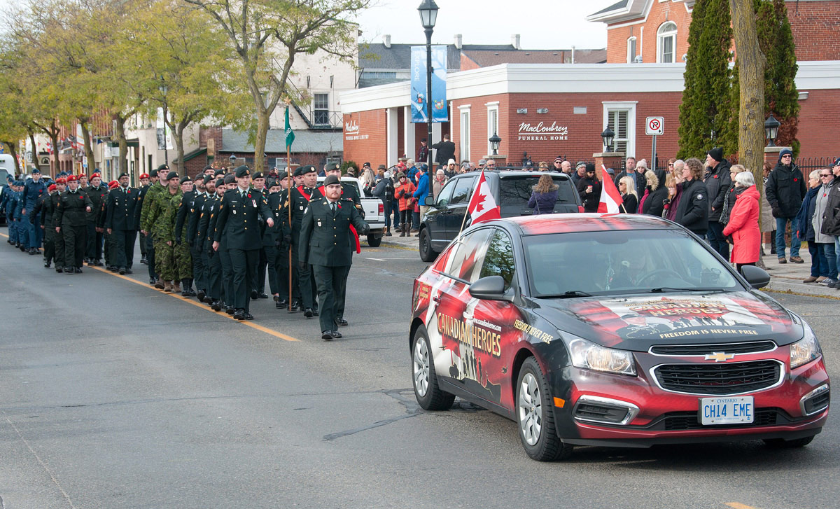 Marchers behind Canadian Heroes Car