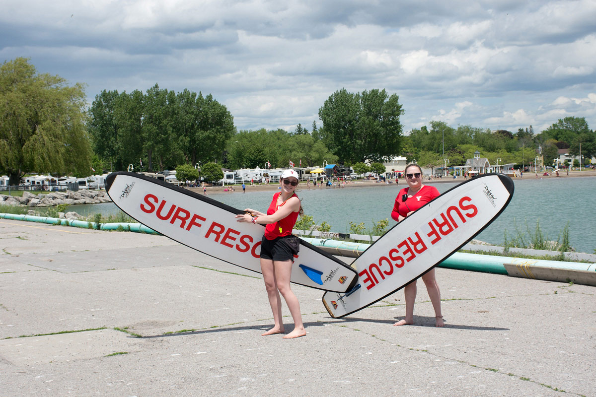 Lifeguards showing off their 'Surf Rescue' boards