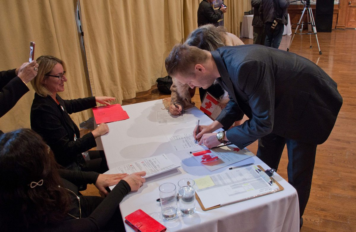 Citizenship ceremony - signing the certificates